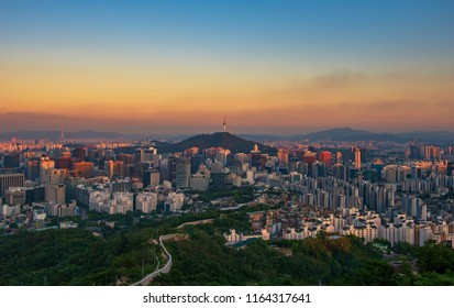 Inwangsan mountain, Seoul City view looking at seoul tower at sunrise in South Korea.