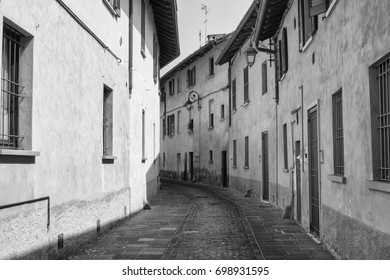 Inzago (Milan, Lombardy, Italy): a typical old street. Black and white
