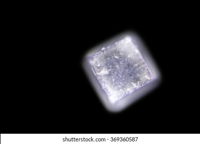 Iodized table salt crystals photographed through a Microscope at 10x their normal size. Photo taken with a DSLR through a Microscope. Lighting from above. unfocused