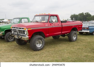 IOLA, WI - JULY 12:  1977 Red Ford F150 Pickup Truck at Iola 42nd Annual Car Show July 12, 2014 in Iola, Wisconsin.