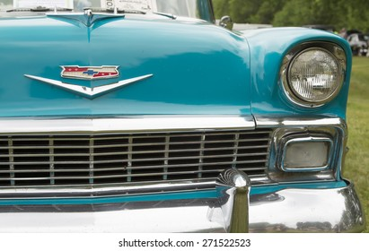 IOLA, WI - JULY 12:  Grill and headlight on 1956 Chevy Bel Air Blue and White Car at Iola 42nd Annual Car Show July 12, 2014 in Iola, Wisconsin.