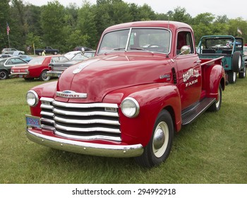 IOLA, WI - JULY 12:  Vintage Red Chevy 3600 Pickup Truck at Iola 42nd Annual Car Show July 12, 2014 in Iola, Wisconsin.