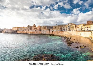 Ionian coast of Ortigia island, a part of Siracusa. Travel photo for a postcard. Sicily, Italy, Europe.