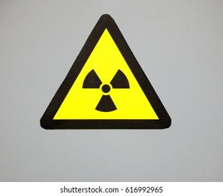 Ionizing radiation trefoil symbol painted on the metal surface. Radioactivity sign.