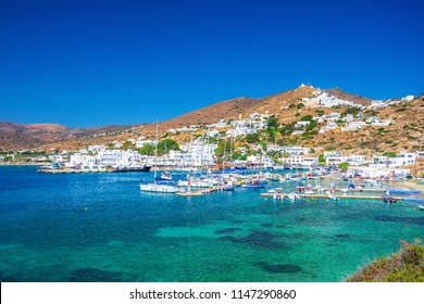 Ios Chora and old harbor at sunset, Cyclades, Greece.