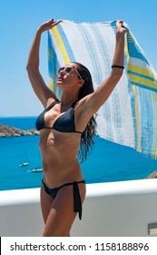 Ios, Greece, 06-13-2016, beautiful woman posing in the balcony of her  hotel