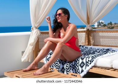 Ios, Greece, 06-13-2016, woman is relaxing in her vacation
