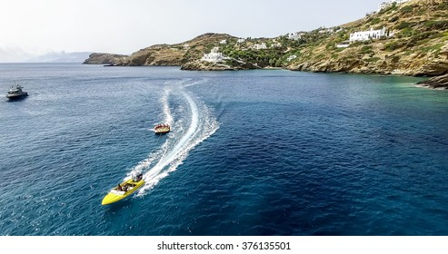 Ios, Greece - September 19, 2015: Tourists having fun on inflatable watercraft boat at the beautiful ocean of Greek island of Ios island, Cyclades, Greece.