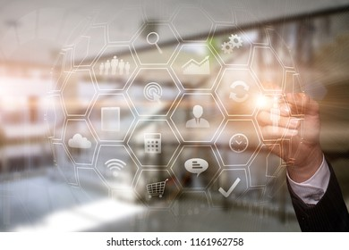 IOT. Businessman working with touch screen write on virtual globe sphere in office icon internet of things