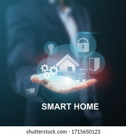 IOT concept. Collage of businessman with open hand and SMART HOME symbols on virtual screen