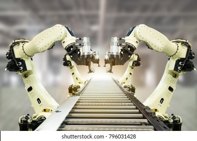 iot industry 4.0 technology concept.Smart factory using trending automation robotic arms with part on conveyor belt in operation line. Automotive manufacturing use it for precision, Repetition,intense