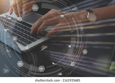 IoT, Internet of Things, Business tecnology, e commerce concept. Man programmer working on laptop computer with modern computer icons interface