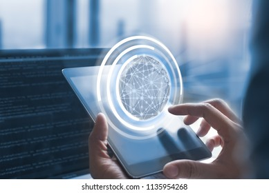 IoT, internet of Things concept. Business man or software engineer hand working on digital tablet with wireless network globalization interface and coding program on laptop computer. blue tone