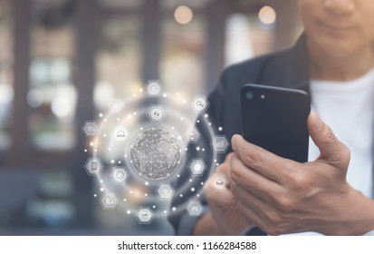 IoT Internet of Things concept. Omnichannel marketing via communication network. Man online shopping on mobile apps and smart phone, 4.0 digital technology development, people lifestyle in smart city