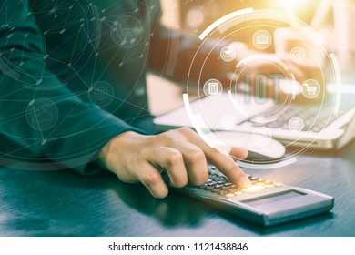 IOT, internet of thinks concept. Business woman accountant or banker making calculations. Savings,Business Financing Accounting Banking and economy Concept. ,Image of hands using calculator on desk.