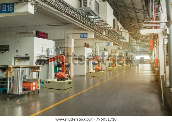 iot smart industry 4.0 concept. Automation robotic arm working in operation machine zone in factory, Robot using in industrial manufacturing for precision, Repetition, intense labor,more productivity