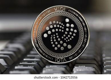 iota coin on a keyboard