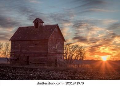 Iowa farm sunset with barn