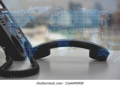IP Phone double exposure of blue LED world map for communication concept