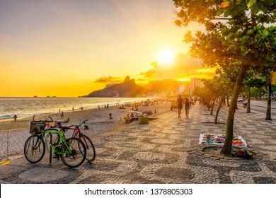 Ipanema beach with mosaic of sidewalk in Rio de Janeiro, Brazil. Ipanema beach is the most famous beach of Rio de Janeiro, Brazil. Sunset cityscape of Rio de Janeiro