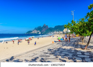 Ipanema beach with mosaic of sidewalk in Rio de Janeiro, Brazil. Ipanema beach is the most famous beach of Rio de Janeiro, Brazil. Cityscape of Rio de Janeiro