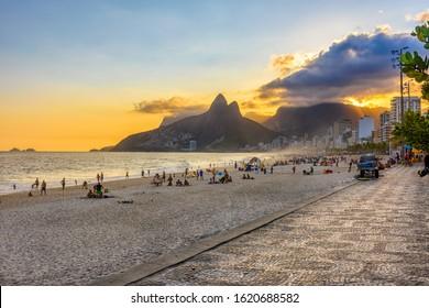 Ipanema beach with mosaic of sidewalk in Rio de Janeiro, Brazil. Ipanema beach is the most famous beach of Rio de Janeiro, Brazil. Cityscape of Rio de Janeiro.
