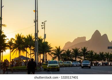 Ipanema beach in Rio de Janeiro, Brazil - January 7, 2019: People practicing exercises and enjoying the beautiful sunset on the beach of ipanema in rio de janeiro.