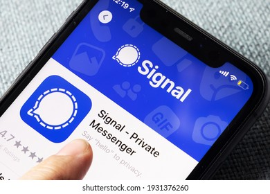 iPhone 11 on blue background with new messenger app Signal logo and icon displayed. Signal is a new application for messaging with high focus on privacy. New York. United states of America 2021.01.05