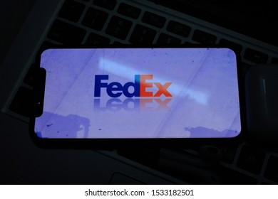 Iphone 11 pro with the FEDEX logo. Fedex, Inc. is an e-commerce company. United States, New York, Wednesday, October 16, 2019