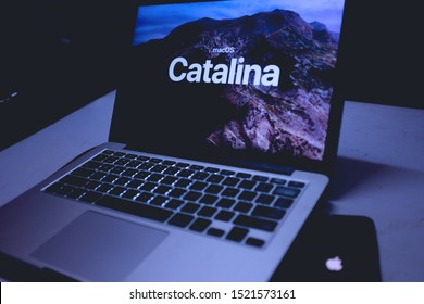 iphone 11 pro and MacBook with Mac OS Catalina background logo on the screen, new operating system which will be released in the fall of 2019. United States, New York, Thursday, October 3, 2019.