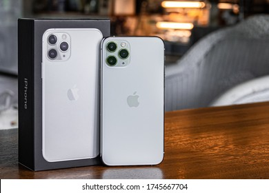 IPHONE 11 Pro Silver With Box on the wood table