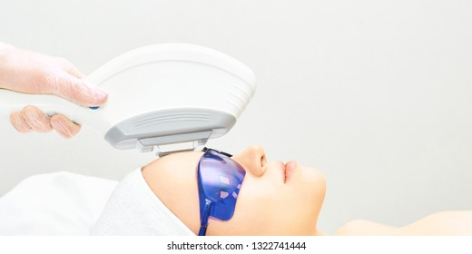 IPL laser clinic treatment. Cosmetology medical procedure. Face skin ejuvenation. Beautician device. Anti acne. Young beautiful girl. Woman facial care.