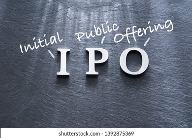 IPO abbreviation by wood letters on wood background, IPO is Initial Public Offering