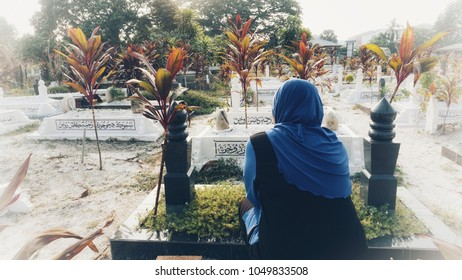 Ipoh Malaysia - 17 March 2018: View of Muslim cemeteries. For muslims the grave should be aligned perpendicular to the Qibla ( Mecca). There is Arabic words means God blessing. Blurry, grain, noise