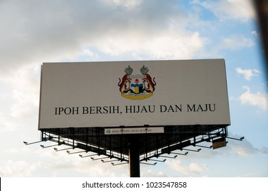 IPOH, MALAYSIA - FEBRUARY 3, 2018 : View from inside car of advertising about local government mission and vission