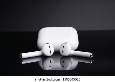 Ipoh, Perak, Malaysia, 16 September 2019 - Air Pods 2 with Wireless Charging Case. New Airpods 2019 on black background.