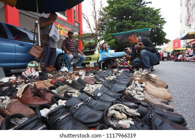 IPOH, PERAK, MALAYSIA - 17 June 2018 - Hawkers and shoppers at Pasar Karat Loken or Ipoh Memory Lane Street. Loken market is also the hunting ground for avid vintage item collectors.