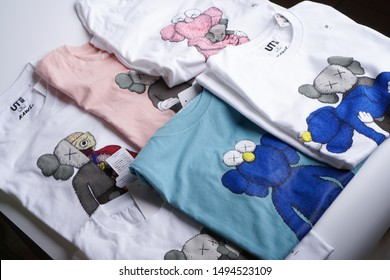Ipoh, Perak, Malaysia, 30 August 2019 - Uniqlo X Kaws shirt design isolation on white background. This is the last Uniqlo collaboration with Kaws.