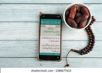 Ipoh, Perak, Malaysia, 4 May 2019 - Digital Quran or Quran apps is used for muslim to refer to the text of the Quran to an electronic device. Ramadan flatlay concept.