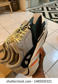 Ipoh, Perak, Malaysia, Circa Mei 2019 - A person holding Adidas Yeezy Wave Runner 700. The adidas YEEZY Wave Runner 700 is Kanye West's new adidas YEEZY running shoe.