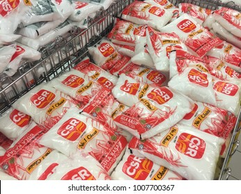 """IPOH,MALAYSIA-20.01.2018 : sugar in packet on the supermarket trolley.""""CSR"""" is one of the biggest sugar vendor in Malaysia"""