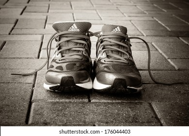 Ipswich, Australia - January 2 2014 - Photo of a pair of Adidas running shoes.  Processed in B&W.