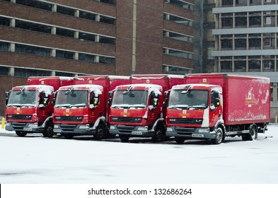 IPSWICH, UK - MARCH 24: Royal Mail trucks snowed-in. Severe weather conditions are causing disruptions to services in many parts of Northern England on 23-24 March 2013.