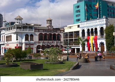IQUIQUE, CHILE - JANUARY 22, 2015: Unidentified people on Plaza Prat main square with the buildings of Scotiabank, the Croatian Club and Casino Espanola on January 22, 2015 in Iquique, Chile