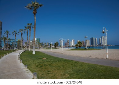 IQUIQUE, CHILE - JULY 7, 2015: Walkway and palm trees along Cavancha Beach in Iquique, northern Chile.