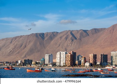 Iquique, Chile - March 17, 2011: Wooden fishing boats in the harbour are resting after the storm