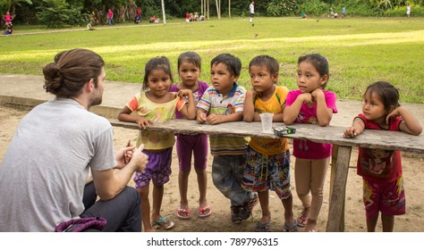 Iquitos, Peru - 21 04 2017: Children intrigued by newcomer to their village