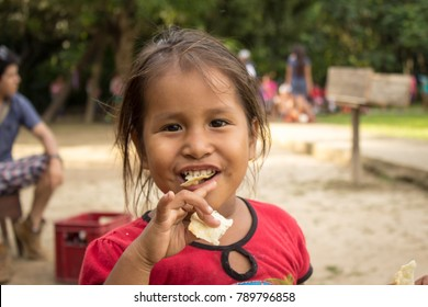 Iquitos, Peru - 21 04 2017: Girl happily eating
