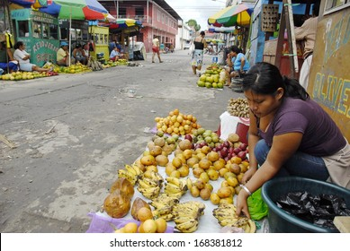 IQUITOS, PERU - APRIL 30: Unidentified Peruvian woman sells exotic fruits on a street of Iquitos, Peru on April 30, 2010. Amazon Peru is known for the rich variety of exotic fruits unknown beyond.