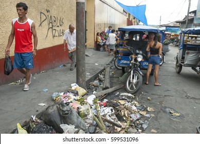 IQUITOS, PERU - APRIL 30: Unidentified people walk in market area in Belen, Iquitos, Peru, April 30, 2010. Belen is the biggest slum in Peru and the most polluted district of Iquitos.